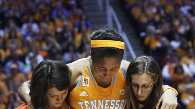 Tennessee center Isabelle Harrison (20) is helped from the floor by trainer Jenny Moshak, right, and an unidentified assistant after being injured in the first half of an NCAA college basketball game against Notre Dame on Monday, Jan. 28, 2013, in Knoxville, Tenn. (AP Photo/Wade Payne)