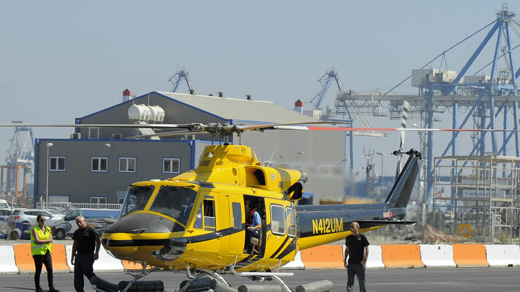 A helicopter ferrying workers to an offshore oil and gas rig belonging to Houston-based Noble Energy Inc. preparing to lift-off from Cyprus Limassol port on Monday, Sept. 19, 2011. The Cyprus government has licensed Noble Energy to begin exploratory drilling some 185 kilometers (115 miles) south of the island coast for what are thought to be potentially sizeable undersea oil and gas deposits, and drilling is expected to begin over the coming days.(AP Photo/Pavlos Vrionides)