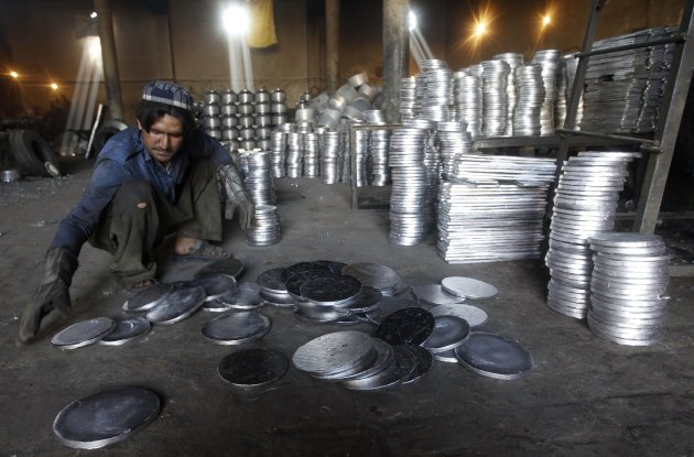 An Afghan man works at an aluminum factory in Jalalabad