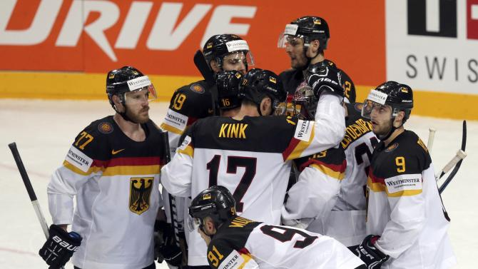 Germany's players react after losing their Ice Hockey World Championship game against Canada at the O2 arena in Prague
