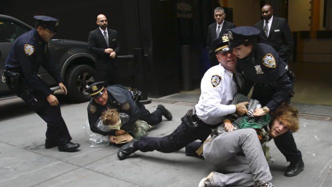 Police arrest marchers from Zuccotti Park's Occupy Wall Street, during a protest near One Chase Manhattan Plaza on Wednesday, Oct. 12, 2011 in New York. The protest is now in its fourth week. (AP Photo/Bebeto Matthews)