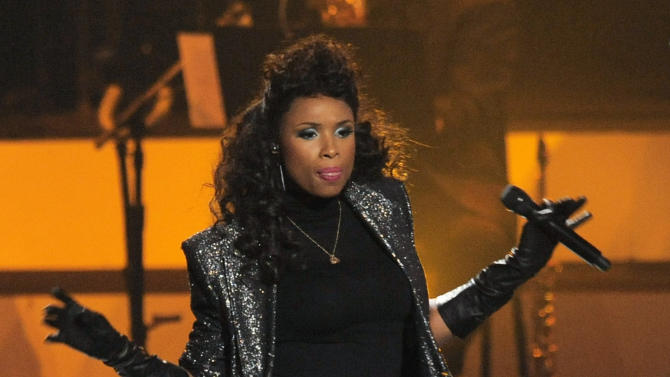 """FILE - In this Oct. 11, 2012 file photo, Jennifer Hudson performs onstage at """"We Will Always Love You: A Grammy Salute to Whitney Houston,"""" at Nokia Theatre in Los Angeles. The Rock and Roll Hall of Fame and Museum announced Wednesday, Jan. 23, 2013, that Hudson, Christina Aguilera and John Mayer are among the stars set to perform at the 28th annual Rock and Roll Hall of Fame induction ceremony to be held on April 18, 2013, in Los Angeles. (Photo by Chris Pizzello/Invision/AP, File)"""