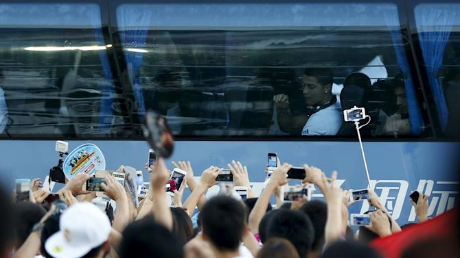 Ronaldo greets fans as Real Madrid arrive at the stadium during the International Champions Cup soccer match against A.C. Milan in Shanghai