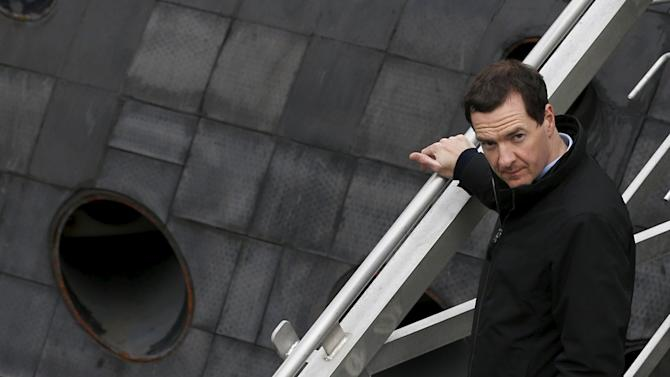 Britain's Chancellor of the Exchequer Osborne walks down the stairs from a submarine at the Royal Navy's submarine base at Faslane