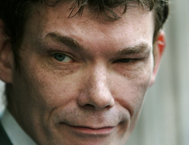 FILE - In this Wednesday May 10, 2006 file photo Gary McKinnon, accused of mounting the largest ever hack of United States government computer networks, listens to a reporter's question outside the Bow Magistrates Court in central London. Britain's Home Secretary is set to rule on Tuesday Oct. 16, 2012, whether to extradite a British hacker to America to face charges for breaking into sensitive computer networks at U.S. military and space installations. (AP Photo/Lefteris Pitarakis, file)