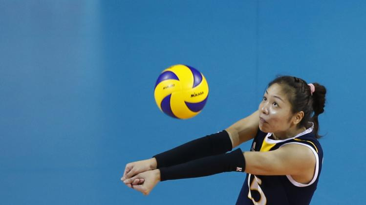 Chen Zhan of China receives a ball from Belgium during their FIVB Women's Volleyball World Grand Prix 2014 final round match in Tokyo