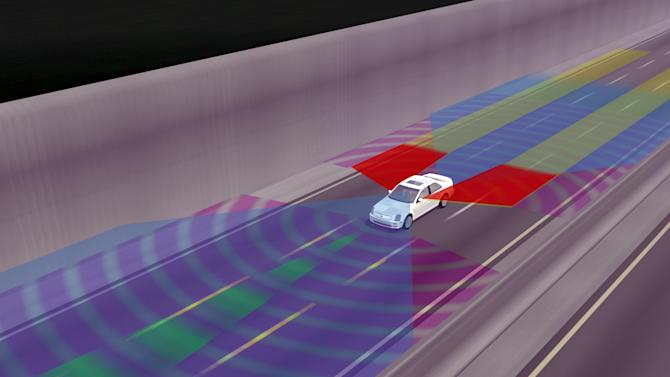 This June 6, 2008 image provided by General Motors shows an illustration  of all-around collision warning in a driverless vehicle. The possibility of driverless cars are leaving a growing number of technologists and economists to wonder what happens to the millions of people who make a living driving cars and trucks. (AP Photo/General Motors)