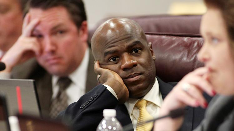 "FILE - This May 10,2011 file photo shows Nevada Assemblyman Kelvin Atkinson, D-North Las Vegas, listens to a debate during a joint budget hearing at the Legislature in Carson City, Nev. The Nevada Senate, after an hour-long, soul-searching debate about equality, love and marriage passed a resolution late Monday repealing the state's heterosexual definition of marriage, the first step in a long process to recognize gay marriage. For Atkinson, it was a coming out of sorts when he announced to many, ""I'm black. I'm gay."" (AP Photo/Cathleen Allison,File)"
