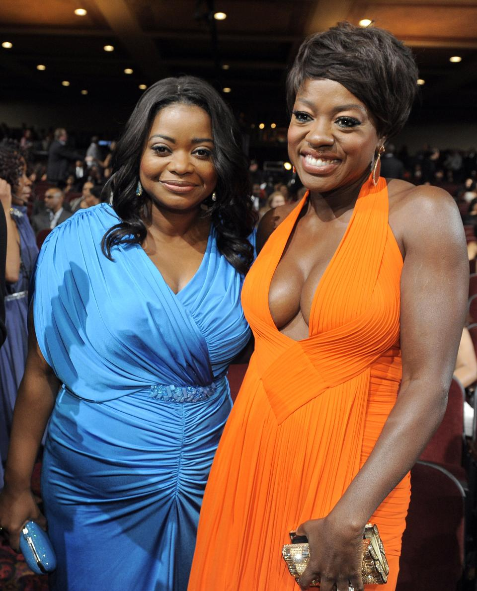 Octavia Spencer, left, and Viola Davis pose in the audience at the 43rd NAACP Image Awards on Friday, Feb. 17, 2012, in Los Angeles. (AP Photo/Chris Pizzello)