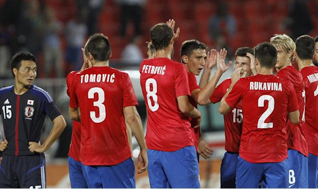Serbian soccer players celebrate after the farewell match of retiring Serbian  soccer player Dejan Stankovic, against Japan, at Karadjordje stadium in Novi Sad, Serbia, Friday, Oct. 11, 2013. Stankovi