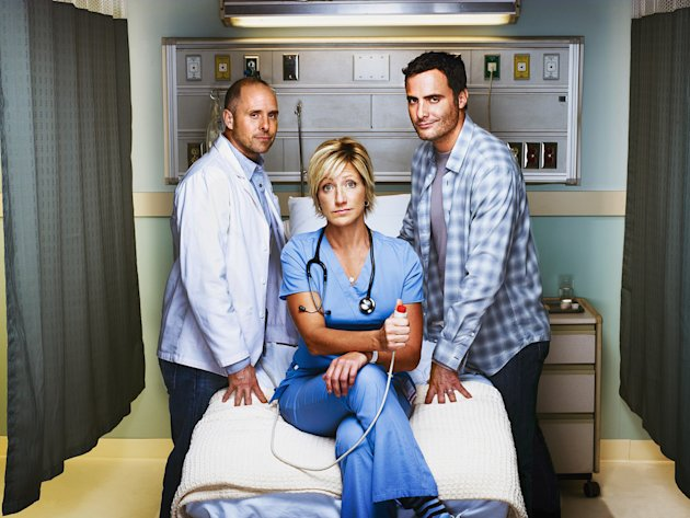 "Paul Schulze as Eddie, Edie Falco as Jackie Peyton, and Dominic Fumusa as Kevin Peyton in ""Nurse Jackie."""