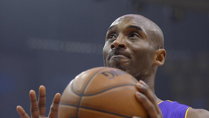 Los Angeles Lakers guard Kobe Bryant reacts during the first half of their NBA basketball game against the Los Angeles Clippers, Friday, Jan. 4, 2013, in Los Angeles.  (AP Photo/Mark J. Terrill)