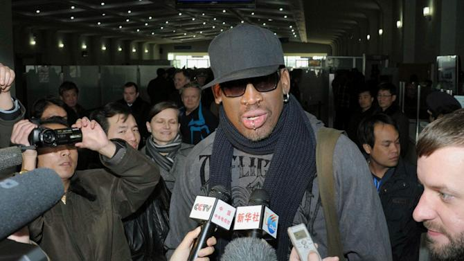 "Former NBA star Dennis Rodman speaks to the media at the Pyongyang Airport in Pyongyang, before he leaves North Korea Friday, March 1, 2013.  Ending his unexpected round of basketball diplomacy in North Korea on Friday, Rodman called leader Kim Jong Un an ""awesome guy"" and said his father and grandfather were ""great leaders.""  (AP Photo/Kyodo News) JAPAN OUT, MANDATORY CREDIT, NO LICENSING IN CHINA, HONG KONG, JAPAN, SOUTH KOREA AND FRANCE"