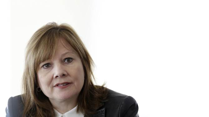FILE - In this Thursday, Jan. 23, 2014, file photo, General Motors CEO Mary Barra ddresses the media during a roundtable meeting with journalists in Detroit. Barra will get a pay package worth $14.4 million this year, 58 percent more than her male predecessor, the company said Monday, Feb. 10, 2014.(AP Photo/Carlos Osorio, File)