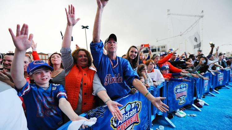 IMAGE DISTRIBUTED FOR ALLSTATE- University of Florida football fans cheer on the Gators at the team's pep rally at the Allstate Fan Fest in New Orleans, La., on Jan. 1, 2012. Florida plays University of Louisville in the 79th Sugar Bowl at the Mercedes-Benz Superdome on Jan. 2, 2012. (Cheryl Gerber/AP Images for Allstate) (Cheryl Gerber/AP Images for Allstate)
