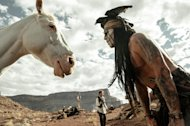 "This publicity image released by Disney shows Johnny Depp as Tonto, right, and Armie Hammer as The Lone Ranger, in a scene from ""The Lone Ranger."" (AP Photo/Disney Enterprises, Inc. and Jerry Bruckheimer Inc., Peter Mountain)"