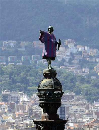 Barcelona's soccer team's new jersey is placed on the Columbus Monument, in Barcelona, Spain, Wednesday, May 22, 2013. Barcelona are the champions of the Spanish La Liga league