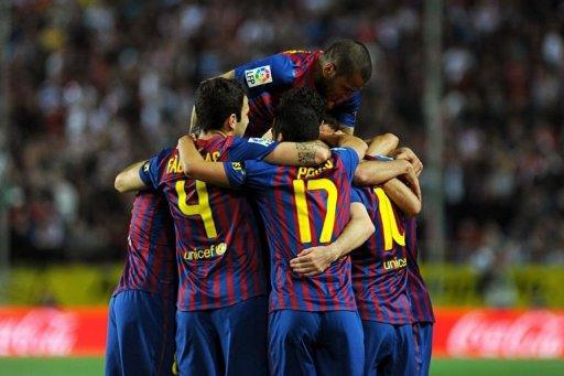 Barcelona's players celebrate during the Spanish league football match Sevilla FC vs FC Barcelona on March 17
