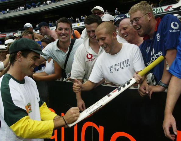 Justin Langer of Australia signs autographs
