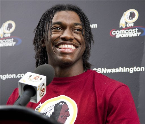 QB Griffin III signs 4-year deal with Redskins