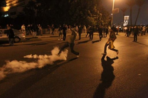An Egyptian protester kicks away a tear gas canister fired by riot police during clashes at Cairo&#39;s landmark Tahrir Square in 2011. Oil-rich Saudi Arabia has distributed $3.7 billion in aid to countries touched by the Arab Spring, most of it to Egypt and Jordan, a report by the International Monetary Fund showed Wednesday