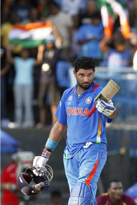 India's Yuvraj Singh acknowledges his century during the Cricket World Cup Group B match between India and West Indies, in Chennai, India, Sunday, March 20, 2011. (AP Photo/Gurinder Osan)