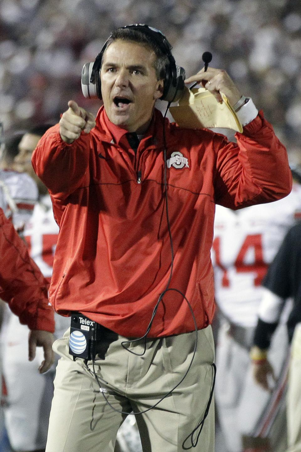 Ohio State head coach Urban Meyer celebrates a touchdown by Ohio State quarterback Braxton Miller (5) during the third quarter of an NCAA college football game against Penn State in State College, Pa., Saturday, Oct. 27, 2012. (AP Photo/Gene J. Puskar)