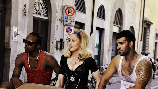"""This undated image released by Guy Oseary shows pop star Madonna, center, during the filming of her music video for her new single, """"Turn Up The Radio,"""" in Florence, Italy. The video will premiere on Vevo on Monday, July 16, 2012.  (AP Photo/Guy Oseary)"""