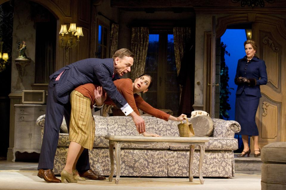"In this theater image released by Boneau/Bryan-Brown, Ben Daniels, left, Spencer Kayden, center, and Patricia Kalember are shown in a scene from the Roundabout Theatre Company's ""Don't Dress for Dinner,"" in New York. (AP Photo/Boneau/Bryan-Brown, Joan Marcus)"