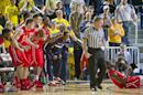 FILE - In this Saturday, Dec. 6, 2014 file photo, N.J.I.T. players celebrate along the bench, as forward Daquan Holiday, bottom right, reacts after drawing a foul late in the second half of an NCAA college basketball game at Crisler Center in Ann Arbor, Mich. After upsetting then-No. 17 Michigan in the regular season, NJIT is headed to the postseason, Thursday, March 5, 2015. (AP Photo/Tony Ding, File)