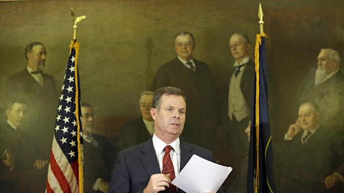Utah Attorney General John Swallow speaks during a news conference Thursday, Nov. 21, 2013, in Salt Lake City. Swallow announced Thursday that he is stepping down amid multiple investigations of bribery and misconduct that have hounded him ever since he took office at the beginning of the year. (AP Photo/Rick Bowmer)