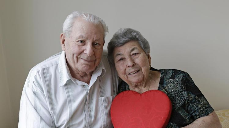 Fortunato Corso, 89, and Maddalena Corso, 88, a Bensonhurst couple married 72 years, pose with a heart at their home in New York, Wednesday, Feb. 13, 2013.  On Thursday they'll be honored by Brooklyn borough President Marty Markowitz in a celebration of couples married 50 years or more. The Corso's, who met as teenagers in Calabria, Italy, and married Feb. 4, 1941, have seven children, three girls and four boys. (AP Photo/Kathy Willens)