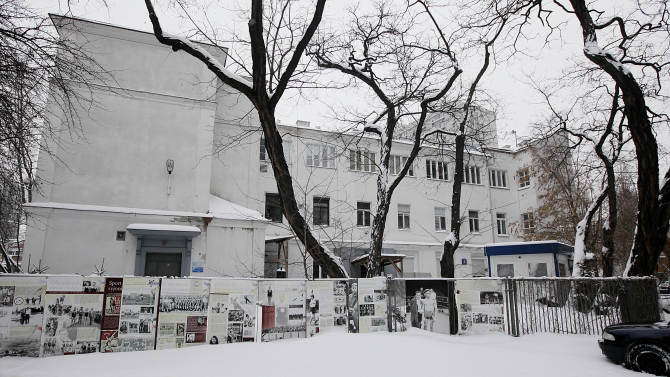 """People walk in front of Warsaw's Jewish community center, known as the """"white building"""" in Warsaw, Poland, Friday, Jan. 25, 2013. The building, one of the few surviving remnants of the infamous Warsaw Ghetto, could be torn down to make way for a taller modern building, a plan that has angered advocates of historic preservation and sparked a battle to save the structure. The Jewish community defends the plan, saying it needs to build a larger and newer building on the spot to accommodate a growing community. (AP Photo/Czarek Sokolowski)"""