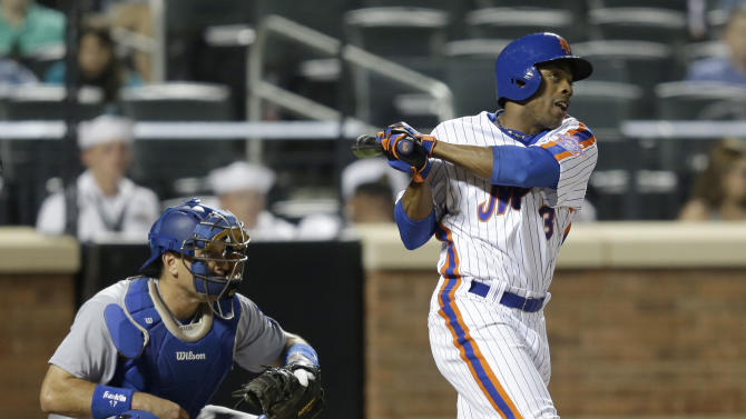 New York Mets' Curtis Granderson looks after a RBI triple during the eighth inning of the baseball game against the Los Angeles Dodgers at Citi Field, Sunday, May 29, 2016 in New York. (AP Photo/Seth Wenig)