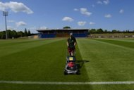 A worker mows the lawn of the training ground at the Spain's football team base camp in the hotel Mistral Sports in Gniewino on June 15 during the Euro 2012 football championships. Spain threw open the doors of their secluded hideaway in northern Poland to offer fans a tantalising glimpse of just how European and world champions live