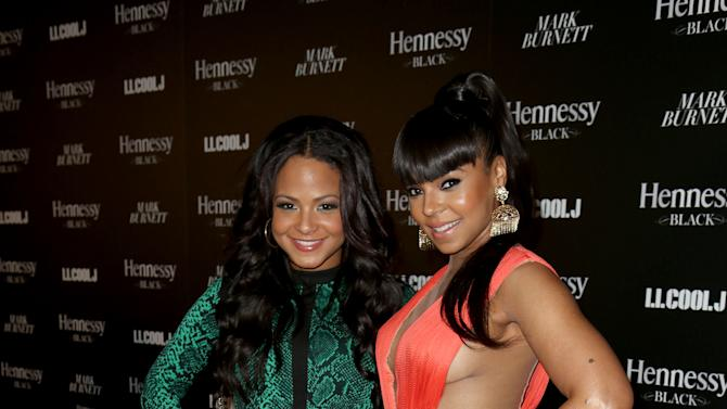 Christina Milian, left, and Ashanti attend Hennessy Black: A Dinner with LL Cool J and Mark Burnett Celebrating Music's Biggest Night Out, on Sat., Feb., 9, 2013 in Los Angeles. (Photo by Casey Rodgers/Invision for Hennessy/AP Images)