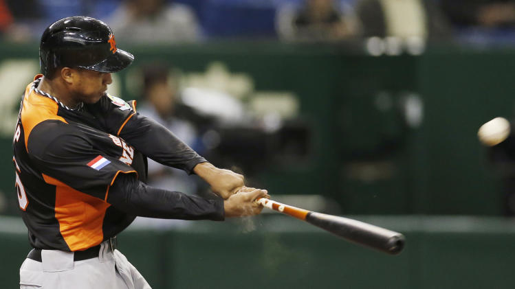 Netherlands' second baseman Jonathan Schoop hits a three-run homer off Cuba's pitcher Yadier Pedroso in the sixth inning of their World Baseball Classic second round game in Tokyo Friday, March 8, 2013. (AP Photo/Koji Sasahara)