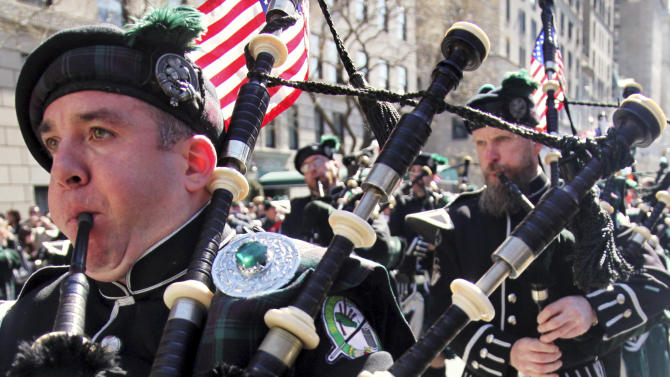 FILE - In this file photo of March 17, 2010, Joseph O'Keefe, left, plays a bagpipe as the Department of Sanitation of New York's Emerald Society Pipes and Drums marches during the St. Patrick's Day parade in New York. In a year when the questions of union power and the responsibility of governments to their employees have taken center stage, St. Patrick's Day is taking on dual meaning for many Irish-Americans, with their rich ties to the labor movement. (AP Photo/Bebeto Matthews, File)