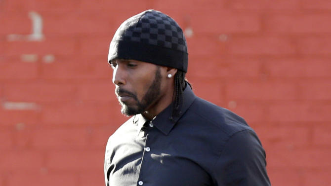 Kansas City Chiefs wide receiver Dwayne Bowe leaves a service for Jovan Belcher at the Landmark International Deliverance and Worship Center, Wednesday, Dec. 5, 2012, in Kansas City, M. Belcher shot his girlfriend, Kasandra Perkins, at their home Saturday morning before driving to Arrowhead Stadium and turning the gun on himself. (AP Photo/Ed Zurga)