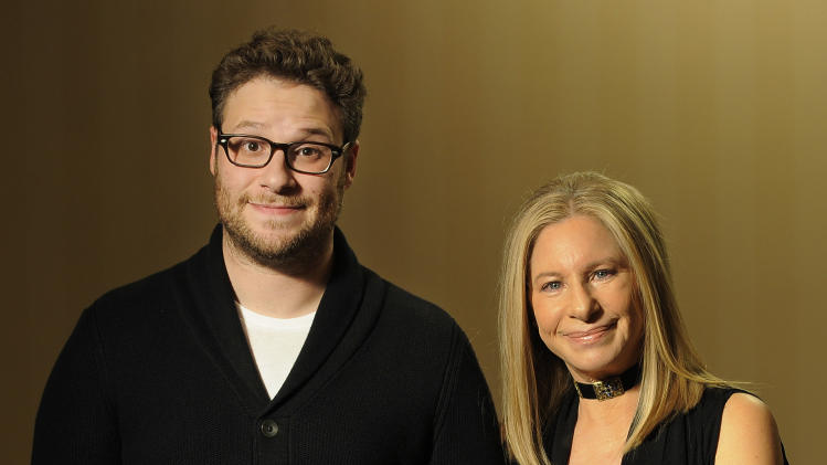 """In this Dec. 11, 2012, photo, Seth Rogen, left, and Barbara Streisand, cast members in the film """"The Guilt Trip,"""" pose together for a portrait at The Four Seasons Hotel in Beverly Hills, Calif. (Photo by Chris Pizzello/Invision/AP)"""