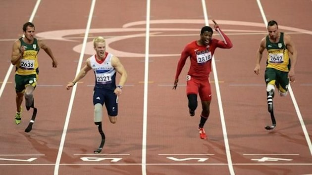 Britain's Jonnie Peacock (2L) crosses the line to win the men's 100m T44 final ahead of (L-R) South Africa's Arnu Fourie, US athlete Richard Brown and South Africa's Oscar Pistorius (AFP)