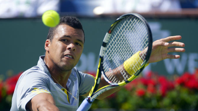 Jo-Wilfried Tsonga, of France, returns a shot to Novak Djokovic, of Serbia, at the BNP Paribas Open tennis tournament, Friday, March 15, 2013, in Indian Wells, Calif. (AP Photo/Mark J. Terrill)