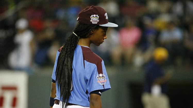 Philadelphia's Mo'ne Davis (3) pauses during a play review during the second inning of an elimination baseball game against Chicago at the Little League World Series tournament in South Williamsport, Pa., Thursday, Aug. 21, 2014. Chicago won 6-5. (AP Photo/Gene J. Puskar)