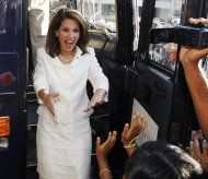 Republican presidential candidate Rep. Michele Bachmann, R-Minn., reacts to a group of supporters as emerges from her campaign bus after winning the Republican Party's Straw Poll in Ames, Iowa, Saturday, Aug. 13, 2011. (AP Photo/Charles Dharapak)