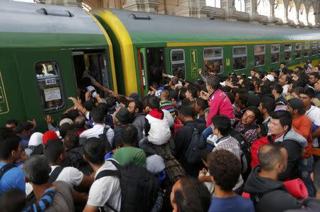 Migrants leave Budapest for Austrian frontier; pressure builds for EU action