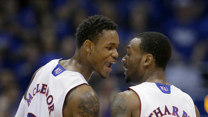 Kansas guards Ben McLemore (23) and Naadir Tharpe (1) celebrate a basket during the first half of an NCAA college basketball game Saturday, Dec. 8, 2012, in Lawrence, Kan. (AP Photo/Charlie Riedel)