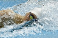 Germany's Paul Biedermann competes in the men's 200-meter freestyle swimming heat at the 2012 Summer Olympics, Sunday, July 29, 2012, in London. (AP Photo/Daniel Ochoa De Olza)