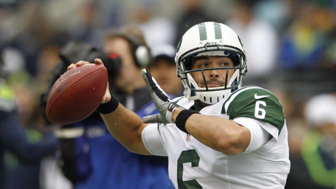 New York Jets quarterback Mark Sanchez warms up on the field before an NFL football game against the Seattle Seahawks, Sunday, Nov. 11, 2012, in Seattle. (AP Photo/Elaine Thompson)