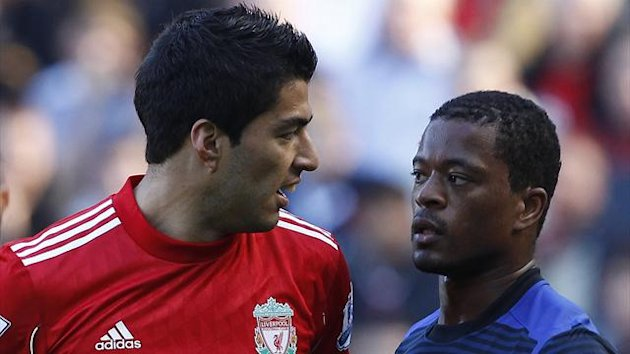 Liverpool's Luis Suarez (L) looks at Manchester United's Patrice Evra (R) during their English Premier League soccer match at Anfield in Liverpool, northern England October 15, 2011 (Reuters)
