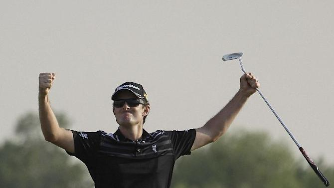 Justin Rose from England celebrates after he finishes -21 on 18th hole during the final round of DP World Golf Championship in Dubai, United Arab Emirates, Sunday Nov. 25, 2012. (AP Photo/Kamran Jebreili)